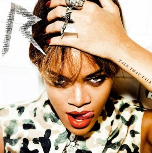 """As with her """"We Found Love"""" single, Rihanna's Talk That Talk album covers have been unlocked by her fans on Facebook. The Esquire and UK Vogue cover girl licks her lips seductively while clutching her head — a """"TALK THAT TALK"""" tattoo revealed on her wrist — on the front of the regular version. Meanwhile, the deluxe edition of RiRi's sixth LP features a black and white shot of the singer, with her hair down as smoke pours out of her mouth. Catch the latter image below.   What do you think of…"""