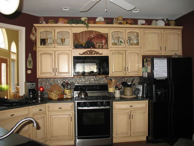 I like the cabinet colors but the black appliances don 39 t for Kitchen cabinets 999