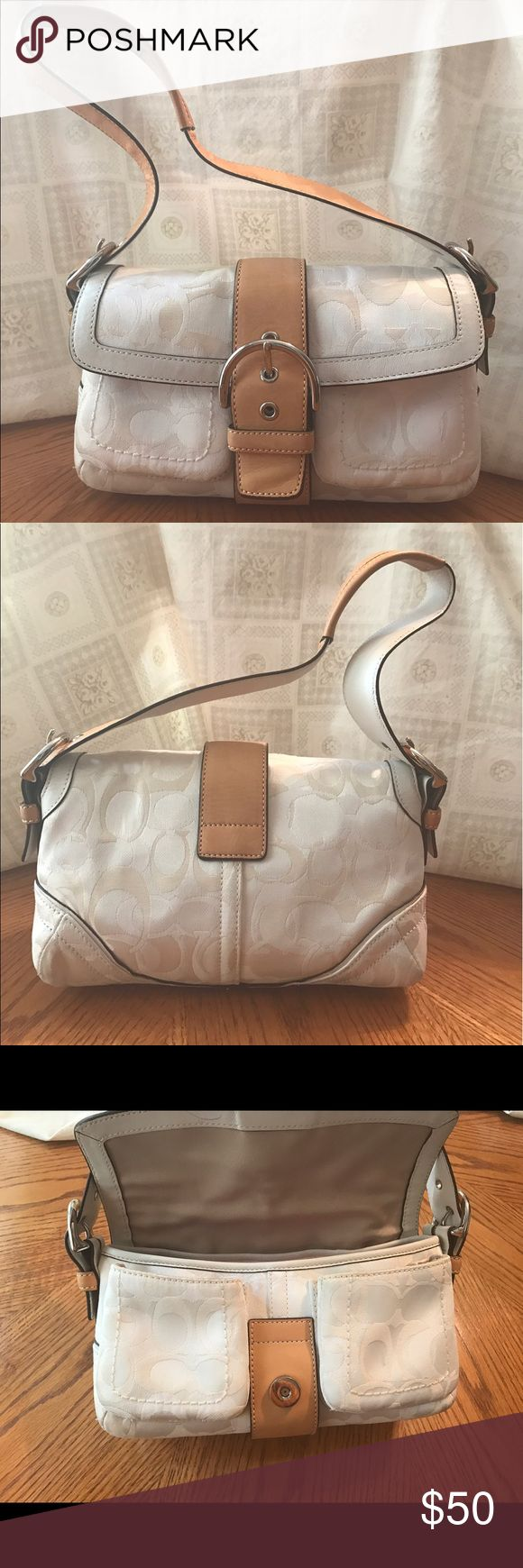 Authentic Coach Shoulder Bag Beautiful Authentic Coach bag. Light cream in color, very clean and in excellent condition. The bag size is between Medium and Small. There is a dark mark on the underside of the shoulder strap. Coach Bags Shoulder Bags