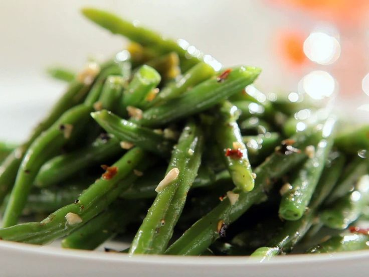 Food Network invites you to try this Italian Green Beans recipe from Sandra Lee.