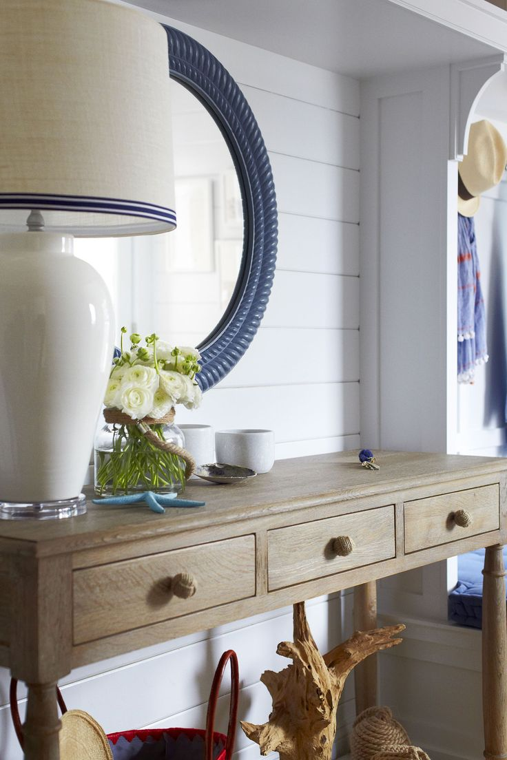 Beach Bungalow Foyer Features A Round Blue Rope Mirror Lining A Shiplap  Wall Lined With A Wood 3 Drawer Console Table Adorned With Knotted Rope  Knobs And