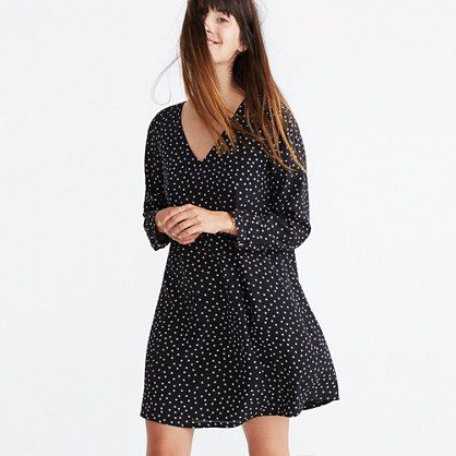 """A charming silk style with a V-neck and buttons all the way down the back. The kind of versatile work-to-party dress that looks as good with sneakers as it does with platform boots. <ul><li>Nonwaisted.</li><li>Falls 35 1/2"""" from high point of shoulder.</li><li>Silk.</li><li>Lined.</li><li>Dry clean.</li><li>Import.</li></ul>"""