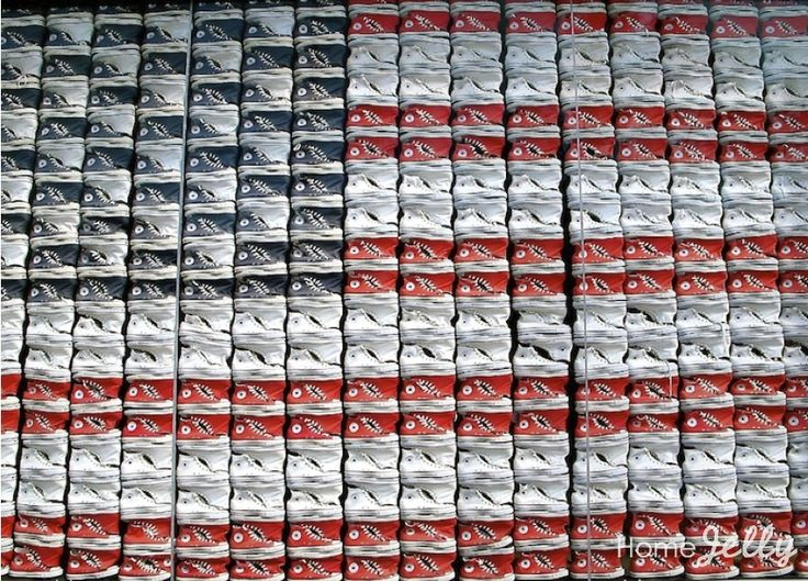 Converse store's window display of repurposed high tops forming an American flag.
