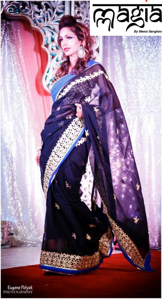 Ranjani wearing the midnight black saree with a touch of gold which makes it more glamorous.