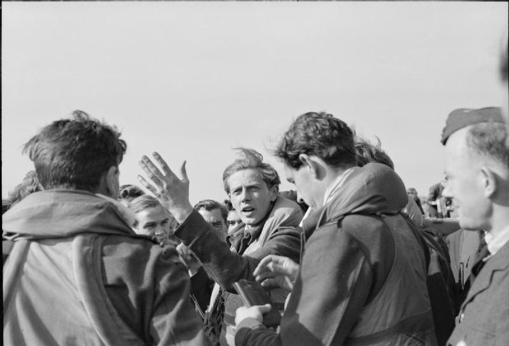 Squadron Leader E F J Charles, Officer Commanding No. 611 Squadron RAF, recounts his experiences to other pilots of the Squadron at Biggin Hill, Kent, on the day after sharing the honour, with Commandant Rene Mouchotte, of shooting down Biggin Hill's 1,000th enemy aircraft.