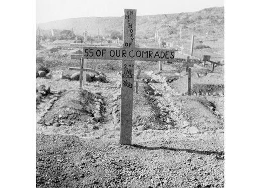 This wooden cross was erected in one of the Gallipoli battlefield cemeteries by soldiers of the 2nd Brigade, AIF, who fought at the Battle of Lone Pine, 6-9 August 1915. The location is not given in the original AWM caption but from the landscape it could be Shrapnel Gully cemetery or possibly Brown's Dip which lay in the gully behind the Lone Pine plateau. The graves at Brown's Dip were removed to Lone Pine Cemetery after the war.  The date on the cross - 7/8/15 - is interesting. The only…