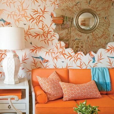 Midcentury modern glamour is right at home in this West Palm Beach condo. The vintage sun-shaped mirror pulls the room together and adds a touch of glint to the room's vibrant orange color scheme. Coastalliving.com