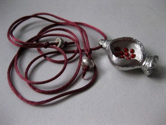 Pomegranate lucky charm jewelry 2014. Rhodiumplated bronze by Tsalapatis