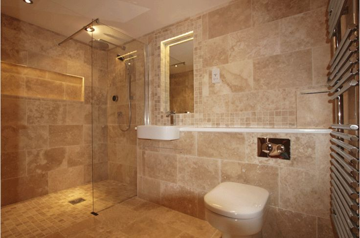 Stunning wetroom using #Travertine #tiles on the walls and floor - add rich berry or plum accessories for a truly opulent #bathroom