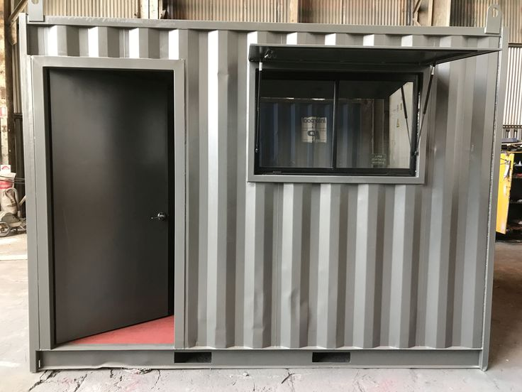 20ft shipping container modified to include personal access door and window shutter.