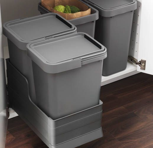 I would really like pull out garbage under my sink, but have plumbing. This might work b/c smaller than normal ones. RATIONELL waste sorting bins and pull-out drawer --> IKEA Catalog 2015