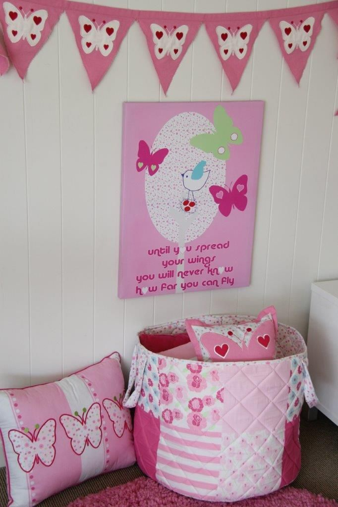 Great ways to dress a wall with bunting & canvases; storage bags for keeping things tidy & cosy cushions at Patersonrose.