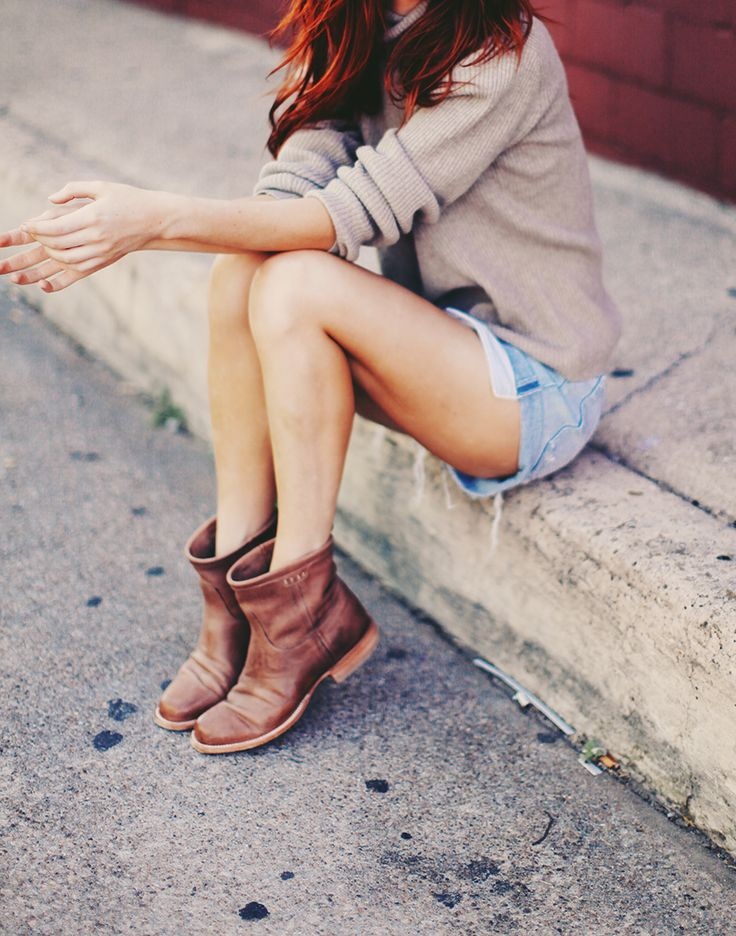 Cozy knit paired with cut-offs and ankle boots via Sea of Shoes