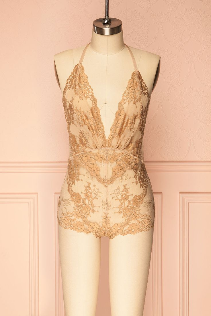 Efia Sand #Boutique1861/ Find your inner seductress with this delicate and revealing bodysuit! The lace and mesh are very stretchable for a comfortable fit that will hug your curves. Transparent everywhere except for the triangular cups and gusset that both feature a lining. The thin T-strap is adjustable for a better fit and shows off your back. Wear it at home with a satin kimono or with high waisted black pants for a risqué evening look.