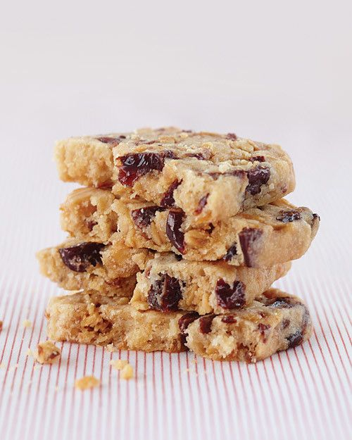 """Dried fruit and nuts may be the ingredients for traditional fruitcake, but here they shine in Allison Hedges' lusciously dense cookies. The secret is in the prep work: Cherries are soaked in sherry with citrus zest, and almonds get a salty-sweet coating for """"pockets of deliciousness."""""""