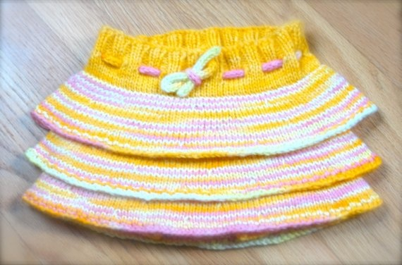 Flirty skirty knitting pattern, uses wool for cloth diapers.