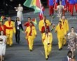 Guyana's flag bearer Winston George holds the national flag as he leads the contingent in the athletes parade during the opening ceremony of the London 2012 Olympic Games at the Olympic Stadium