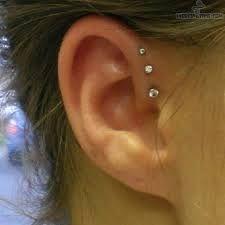 Risultati immagini per piercing orecchio helix