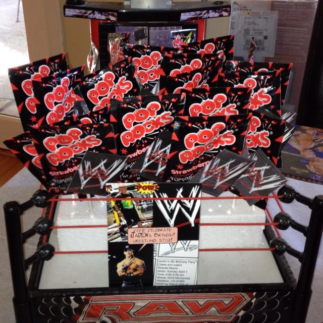 Pop Rocks on sticks displayed on a WWE wrestling ring.