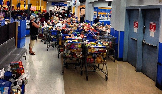 Food-stamp shoppers pick Walmart bare after computer glitch gives them UNLIMITED funds. But who will end up footing the bill?  THE TAXPAYERS, WHO DO YOU THINK!