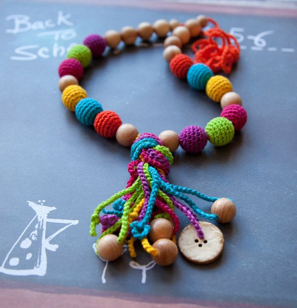 Nursing Necklace - Teething Necklace with a coconut button -Baby Carrier. $32.00, via Etsy.