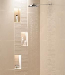 Maybe one tall niche instead of three small ones, like setting the niche in the vertical accent tile strip