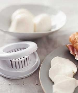Egg slicer as mozzarella slicer -- The wires divide the soft cheese