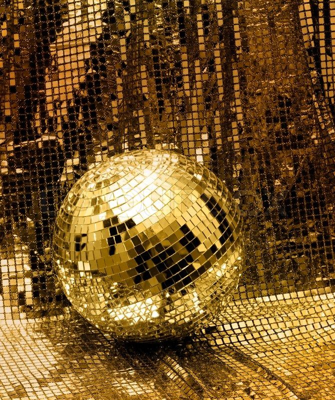 Stock image of 'Golden disco mirror ball reflect light on glitter canvas background'