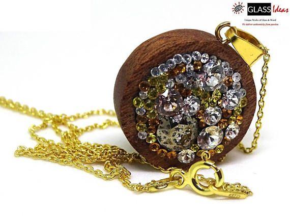 #SterlingSilver #necklace #wood #swarovskiCrystals #goldplated #gold  #CopyrightGlassideas  #GlassIdeas #Sold #OneOfAKindJewelry #WoodenJewelry #Swarovski #sapele #goldplated #statementnecklace #swarovskicrystals #oneofakind #exoticwoodpendant #readytoship #ecofriendlyjewelry #giftforher #naturaljewelry #925sterlingsilver #galaxynecklace #valentinesday #exclusivejewelry