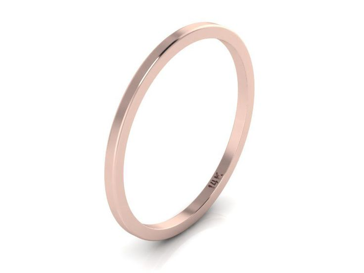 14K Rose Gold band with about 1.1mm width. Looks great with our other rings, stack-able and perfect addition to any ring.