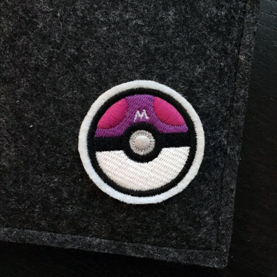 Got to catch them all! When you *own* the game, this masterball patch will show everyone where youre at.  A premium patch embroidered with vivid colours on a durable felt base. It measures approximately 2.0 x 2.0  This patch can be sewn or ironed on to your favorite knapsacks, jeans or jackets. For removable options, choose our pin backed version that has a bar pin fastened to the back.