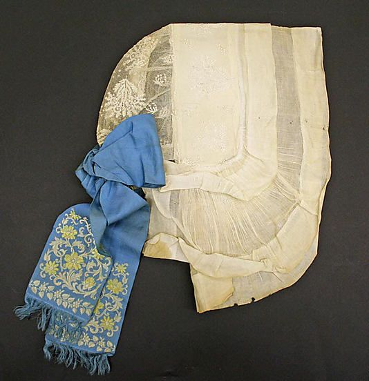 Woman's cap, probably France, 18th century. Cotton, blue silk ribbon with floral embroidery.