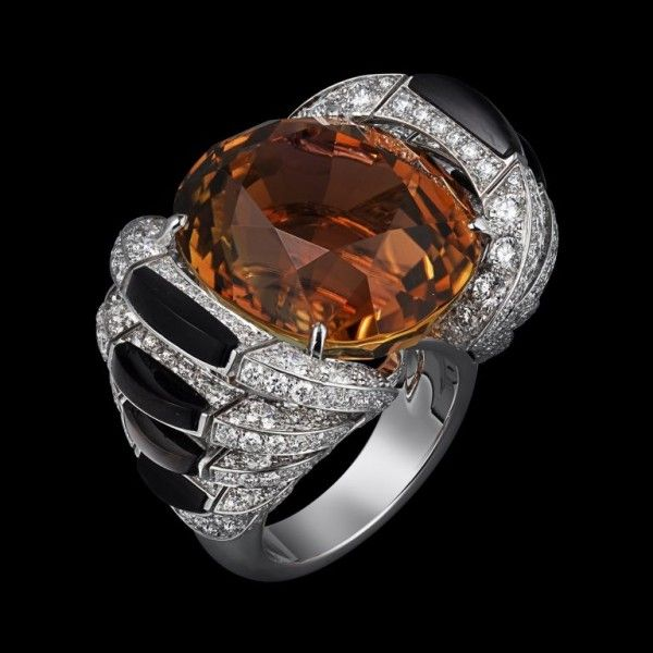Cartier's luxury Odyssey.  A ring in white gold, set with a 33.42ct brown tourmaline, obsidian and diamonds from the L'Odyssée de Cartier collection