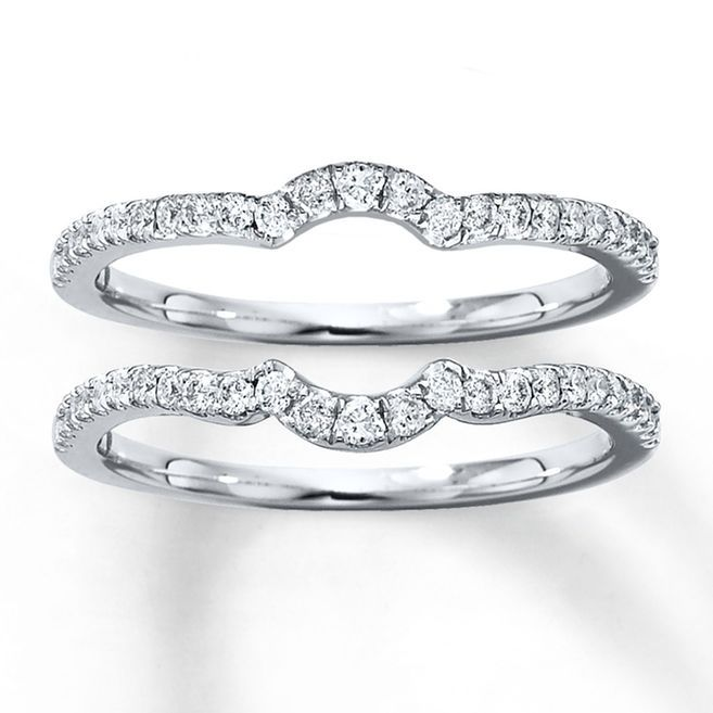 A single row of diamonds curves along each of these matching double wedding bands for her. Crafted in 14K white gold, these rings have a total diamond weight of 3/8 carat. Diamond Total Carat Weight may range from .37 - .44 carats.
