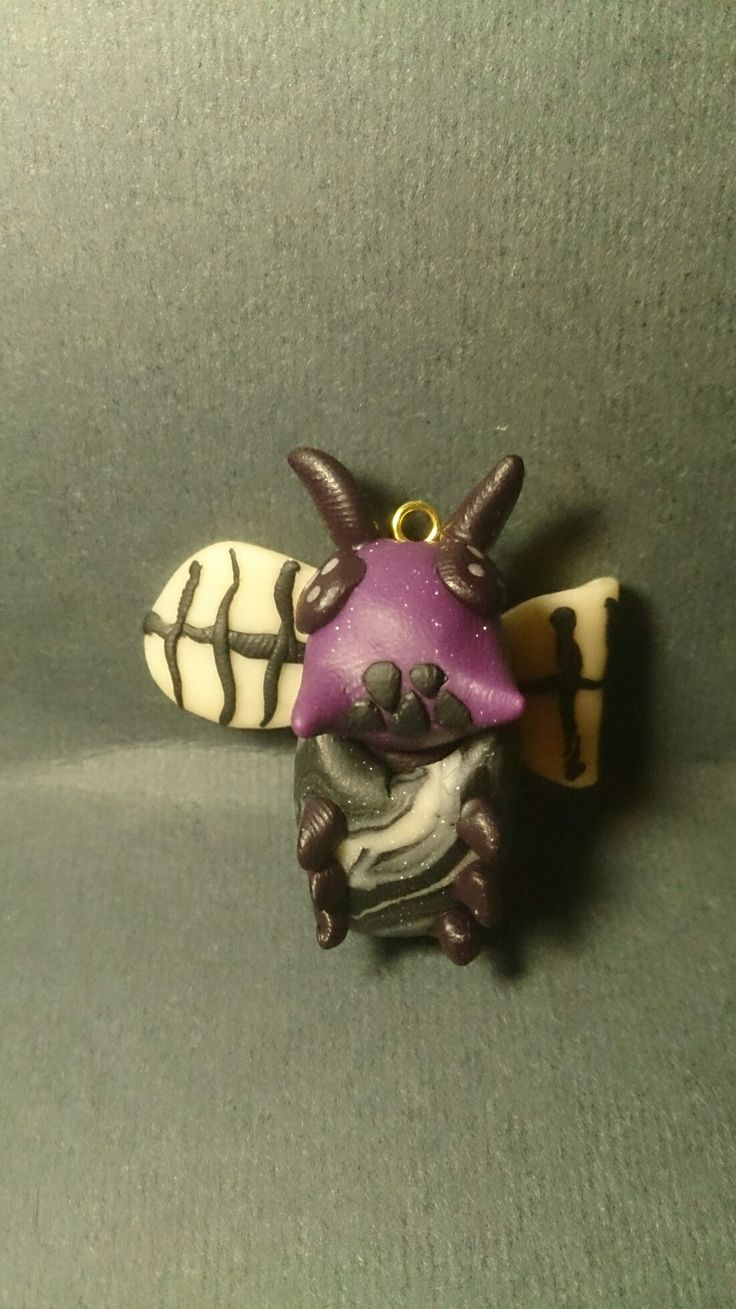 Polymer clay baby flying ant, in egg