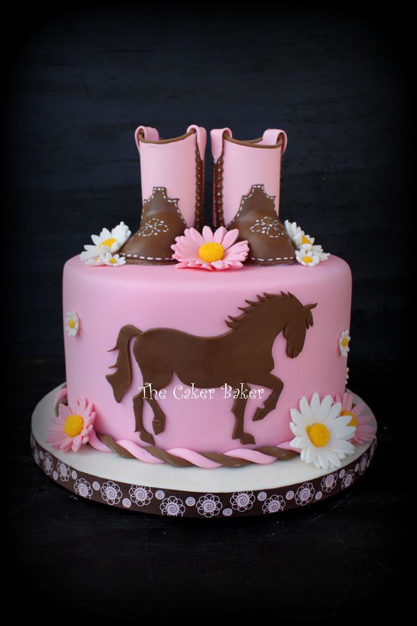 Gumpaste boots and cut out of a horse silhouette. I really enjoyed making this cake. :)
