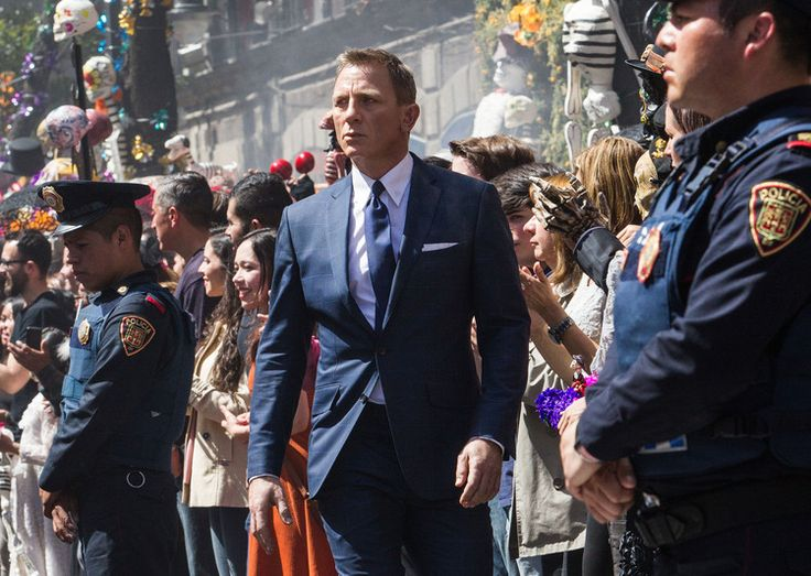 In Spectre, Bond wore his suits slightly longer than in Skyfall, Temime said.