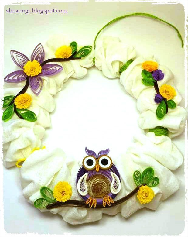 Wreath decorated with quilling flowers and owl #easterwreaths #easterdecoration #handmadewreaths #almanogr