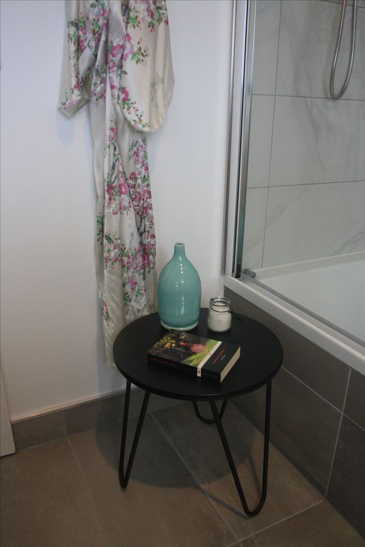 Grey and white modern bathroom with turquoise hints- Japanese kimono in background