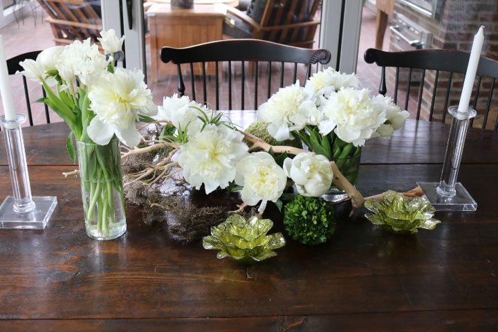 Peony season is our favorite, and these white peonies were beyond gorgeous in person. We mixed them with some soft greens and placed them in a manzanita branch.