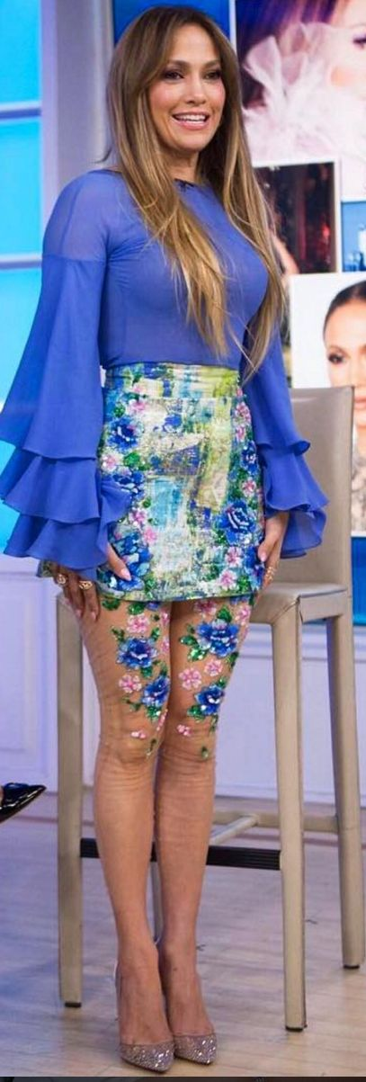 Jennifer Lopezs floral tights, blue top, and skirt