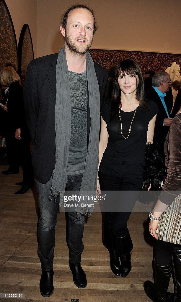 Edward Spencer-Churchill (L) and Annabelle Neilson attend a private view of the Damien Hirst retrospective exhibition at the Tate Modern on April 3, 2012 in London, England.