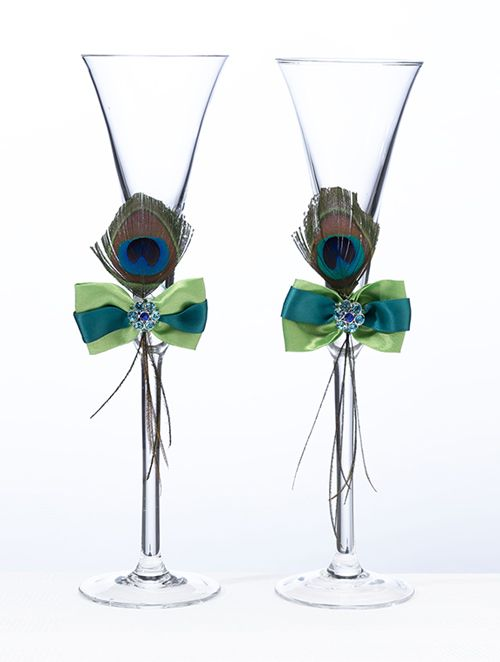 Wedding Peacock Feather Toasting Glasses. Perfect For The Peacock Wedding Theme. www.ceceliasbestwishes.com   Keywords: #peacockweddings #jevelweddingplanning Follow Us: www.jevelweddingplanning.com  www.facebook.com/jevelweddingplanning/