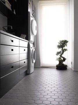 Kennon muotoinen laatta tuo mukavaa vaihtelua kodinhoitohuoneeseen