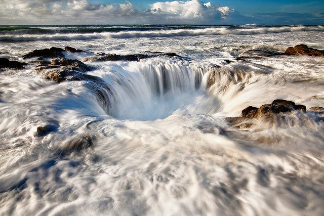 Washed Away by Nathaniel Reinhart: Thor's Well, located on Cape Perpetua on the Oregon coastline is a salt water fountain powered by the Pacific.  While you can see it from the over look, it's so far away and right near the edge so it is hard to distinguish it from the incoming waves.To truly appreciate this you have to stand just a couple of feet next to it.  Although, whatever you do though, don't fall in! #Oregon #Thors_Well