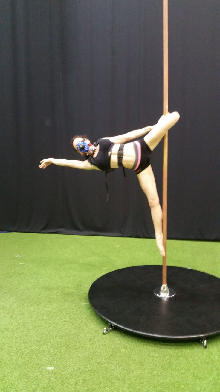 Pole dancer in Cupid position, fitted with K5 wearable metabolic equipment for the measurement of oxygen consumption and other parameters.