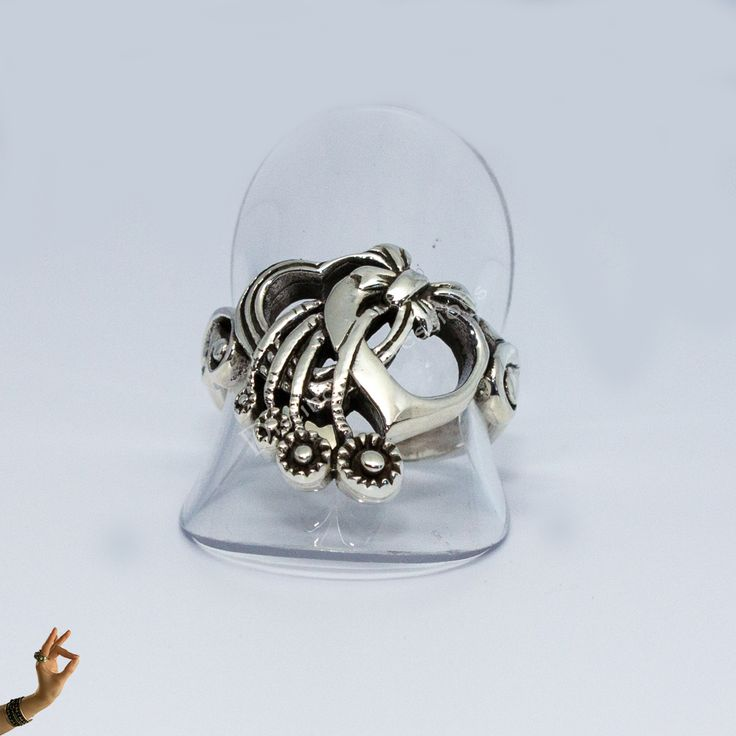 Two Hearts Ring It features two hearts in polished sterling silver with cascading ribbon highlighted by oxidisation.