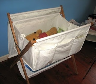 diy bassinet.  Could use a bar height director's chair for the legs?
