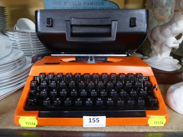 Do you like to type the old fashion way? How cool is this! A retro Brother 210 orange typewriter with case & original box