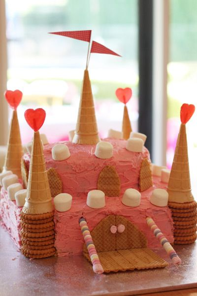 Pink Fairy Princess Birthday Party Castle Cake  I think the 7 year old is leaning toward a volcano cake, but just in case, I could totally rock this cake in red and blue and trick it all out for a boy.